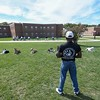 """Eric Bonzar—The Morning Journal<br /> Don Hitchens, trainer for Friendship Animal Protective League, watches over the pack of trainee dogs, as they follow their handler's """"down"""" and """"stay"""" commands in the yard of the Grafton Correctional Institution, Sept. 15, 2016."""