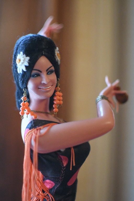 . Eric Bonzar�The Morning Journal<br> A Spanish Flaminco dancer figurine greets guests of Oberlin Heritage Center\'s Monroe House with a smile. For the entire month of September, President and Curator Guillermo Arriaga, of the Museum of Hispanic and Latino Cultures of Lorain, has brought the organization\'s Hispanic Culture exhibit to the historic home for guests to experience.