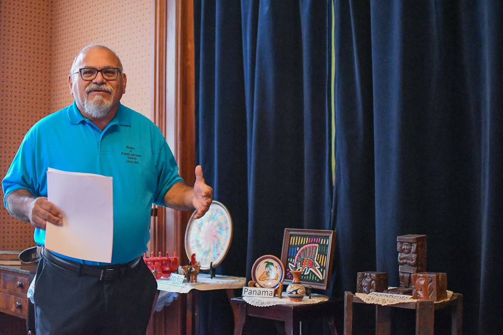. Eric Bonzar�The Morning Journal<br> President and Curator Guillermo Arriaga, of the Museum of Hispanic and Latino Cultures of Lorain, gives a tour of his organization\'s Hispanic Culture exhibit, featured at the Oberlin Heritage Center\'s historic Monroe House, Sept. 19, 2017.