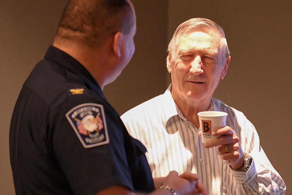 . Eric Bonzar�The Morning Journal<br> Elvis Dollar, of Amherst converses with Avon police Chief Richard Bosley during the department\'s Coffee With a Cop gathering at Barry Bagels, 2100 Center Road, Oct. 4, 2017. Dollar, a retired school teacher, is a member of Avon\'s Christian Heritage Church, which helped to sponsor the event.