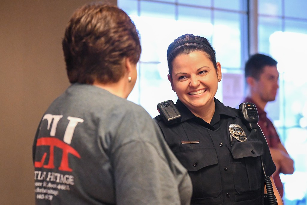 . Eric Bonzar�The Morning Journal<br> Avon police Officer Jeannine Mazzeo smiles as she converses with Rev. Elise Pitts, of Christian Heritage Church, during the department\'s Coffee With a Cop gathering at Barry Bagels, 2100 Center Road, Oct. 4, 2017. Pitts\' church was one of the sponsors of the community building event.