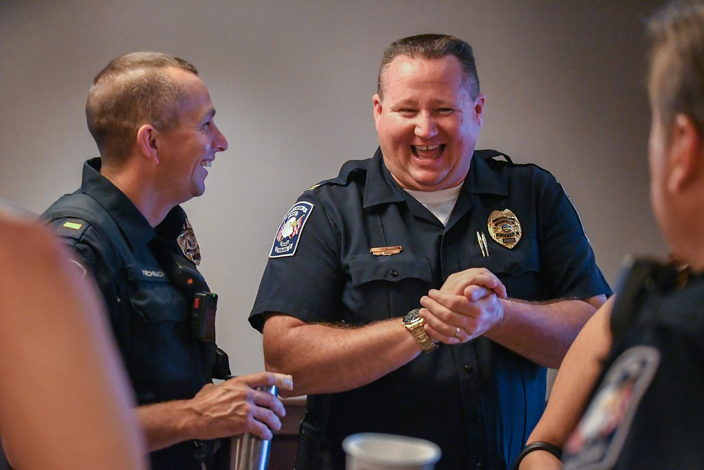 . Eric Bonzar�The Morning Journal<br> Avon police Chief Richard Bosley, right, shares a laugh with Lt. Dan Fischbach during the department\'s Coffee With a Cop gathering at Barry Bagels, 2100 Center Road, Oct. 4, 2017.