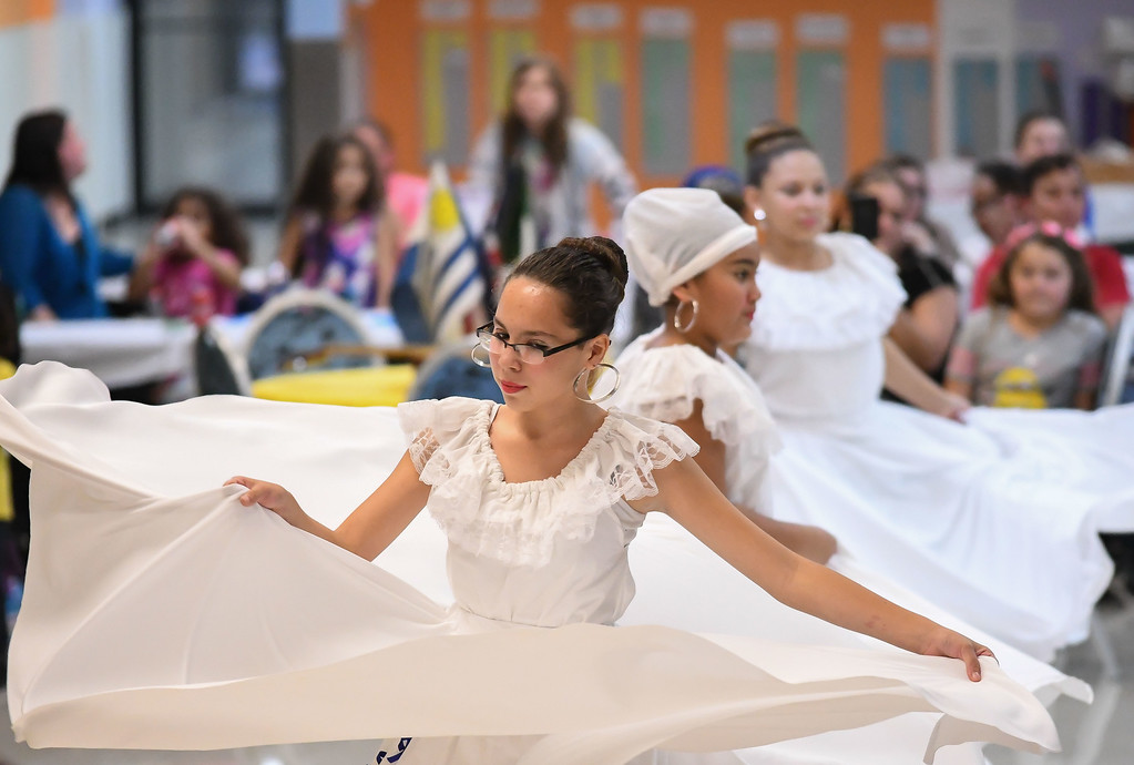 . Eric Bonzar�The Morning Journal<br> Twelve-year-old Lisa Ortiz and her fellow dancers of Esencia Boricua Cultural de Lorain perform during Horizon Science Academy of Lorain\'s Hispanic Celebration Dinner, Oct. 12, 2017.