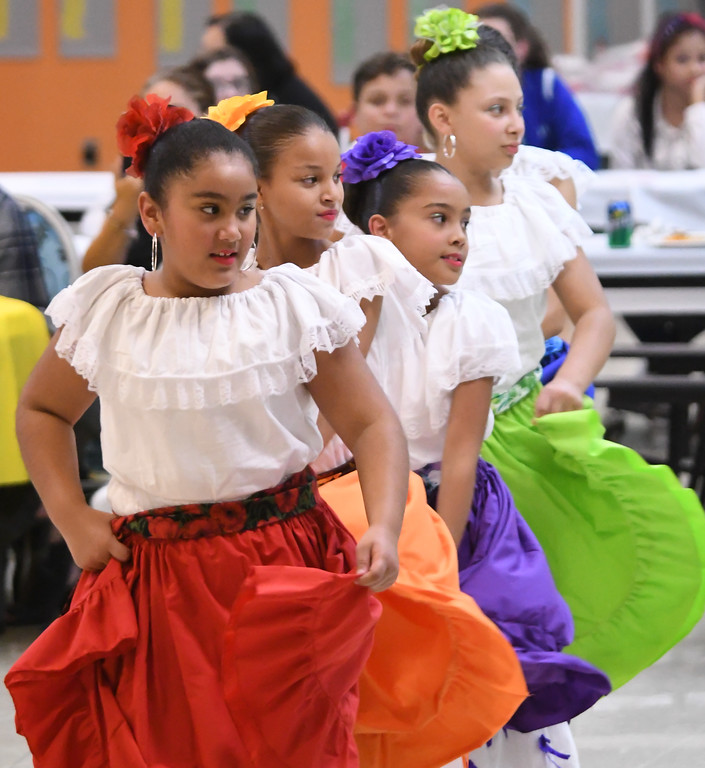 . Eric Bonzar�The Morning Journal<br> Dancers of Esencia Boricua Cultural de Lorain perform during Horizon Science Academy of Lorain\'s Hispanic Celebration Dinner, Oct. 12, 2017.
