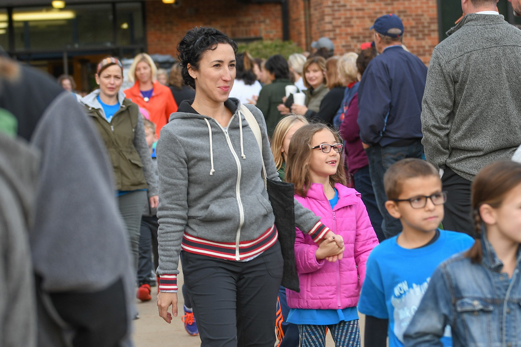 . Eric Bonzar�The Morning Journal Parents, students and healthcare employees from Cleveland Clinic\'s Avon Hospital participated in Eastview Elementary School\'s Walk on Wednesdays (WOW) initiative, Oct. 26, 2016. Wednesday marked the final WOW of 2016, where students were encouraged to bring a friend to walk with and a pair of old shoes to donate to the nonprofit organization Planet Aid.