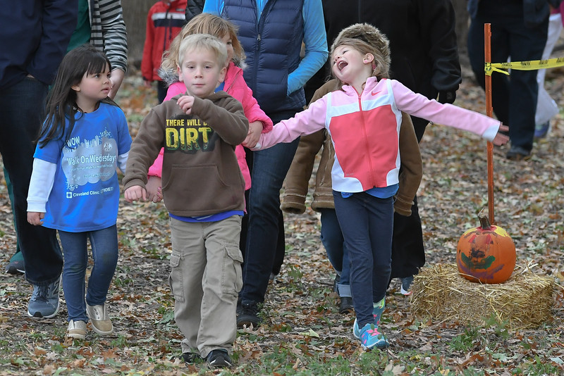 Eric Bonzar—The Morning Journal<br /> Five-Year-old Delaney Mitchell, right, basks in the cool, fall air alongside fellow kindergartner Colton Anderson, 6, and their Eastview Elementary School classmates, during Walk on Wednesdays (WOW), in Avon Lake,  Oct. 26, 2016. For the final WOW of the year, students collected old shoes as donation to Planet Aid, a non-profit organization that re-purposes used and recycled textiles to areas in need across the globe, Eastview Elementary School Principal Mike Matthews said.