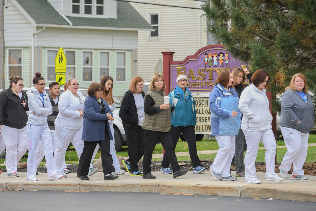 . Eric Bonzar�The Morning Journal Employees from Cleveland Clinic\'s Avon Hospital participate in Eastview Elementary School\'s Walk on Wednesdays (WOW) initiative, Oct. 26, 2016.