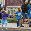 "Eric Bonzar—The Morning Journal<br /> Seven-year-old Alyssa Jones and her service companion ""Mylo"" walk in hand with classmate Kaidyn Luznar, 7, during Eastview Elementary School's Walk on Wednesdays (WOW) initiative, Oct. 26, 2016. Wednesday marked the final WOW of 2016, where students were encouraged to bring a friend to walk with and a pair of old shoes to donate to the nonprofit organization Planet Aid."