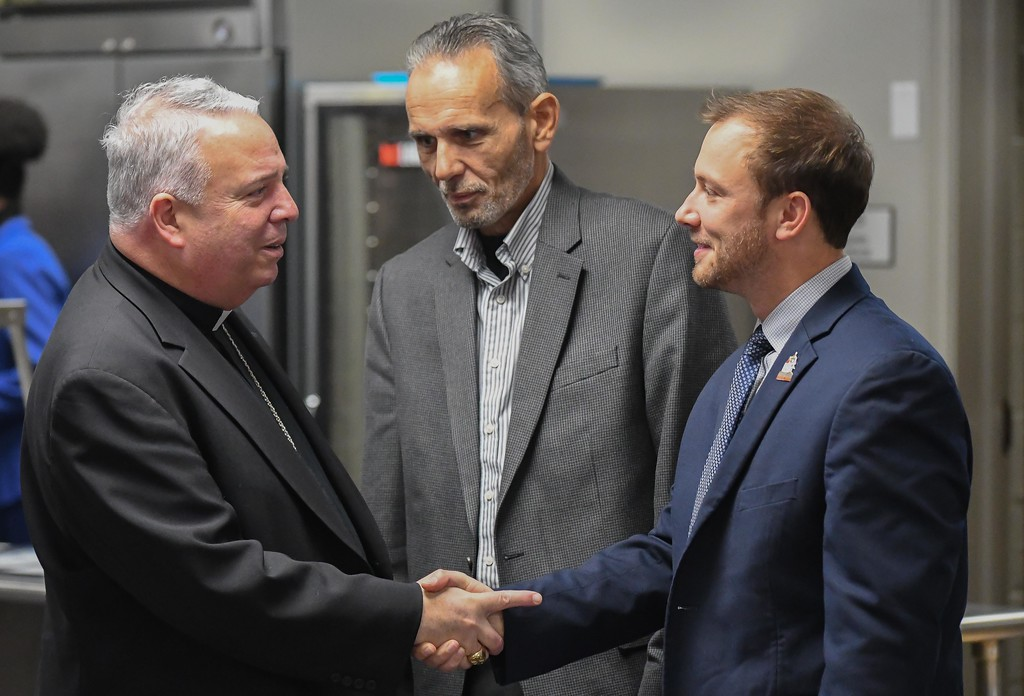 . Eric Bonzar�The Morning Journal<br> Mayor Chase Ritenauer, right, and Lorain County Commissioner Ted Kalo, center, meet with Bishop Nelson J. Perez, during the dedication ceremony of Catholic Charities of the Diocese of Cleveland\'s St. Elizabeth Center, in Lorain, Oct. 31, 2017.