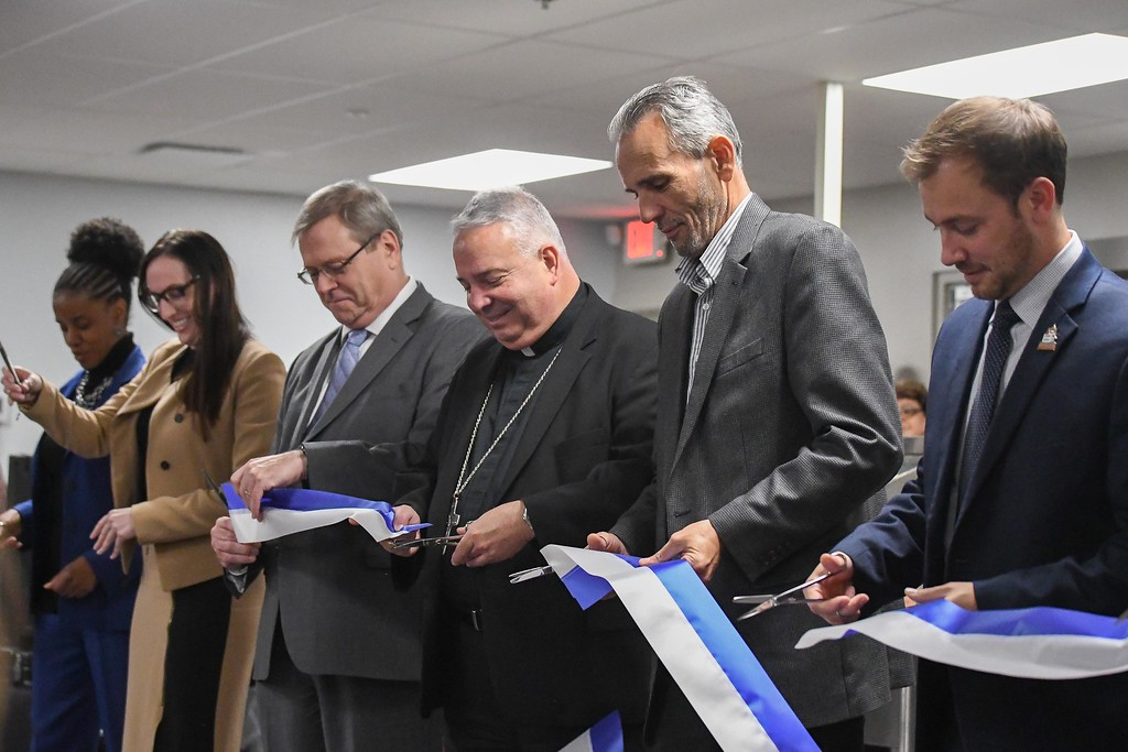 . Eric Bonzar�The Morning Journal<br> Organization leaders and public officials cut the ribbon during Catholic Charities of the Diocese of Cleveland\'s dedication of its St. Elizabeth Center, in Lorain, Oct. 31, 2017.