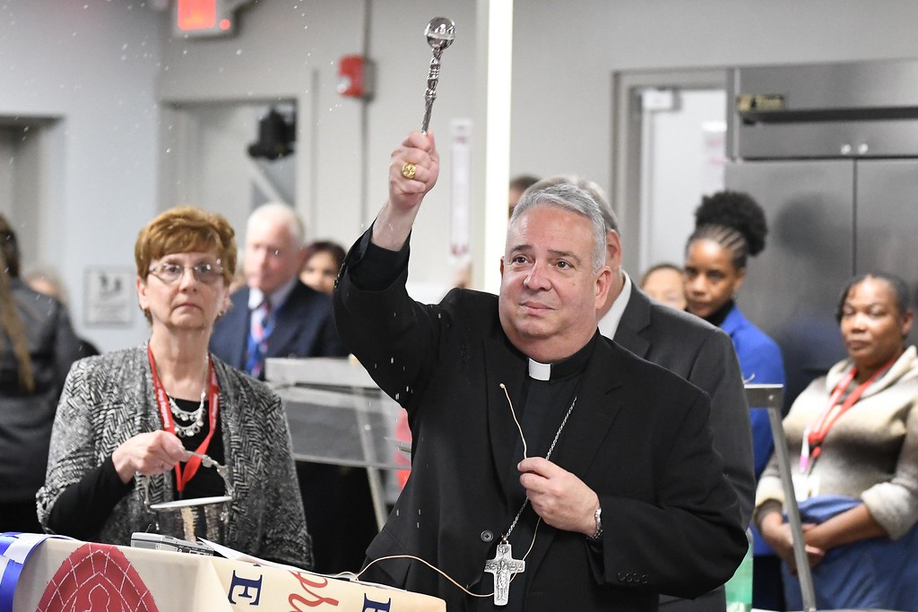 . Eric Bonzar�The Morning Journal<br> Bishop Nelson J. Perez blesses the St. Elizabeth Center during a dedication ceremony of Catholic Charities of the Diocese of Cleveland\'s, 50-bed, men\'s year-round shelter, located at 2726 Caroline Ave., in Lorain, Oct. 31, 2017.