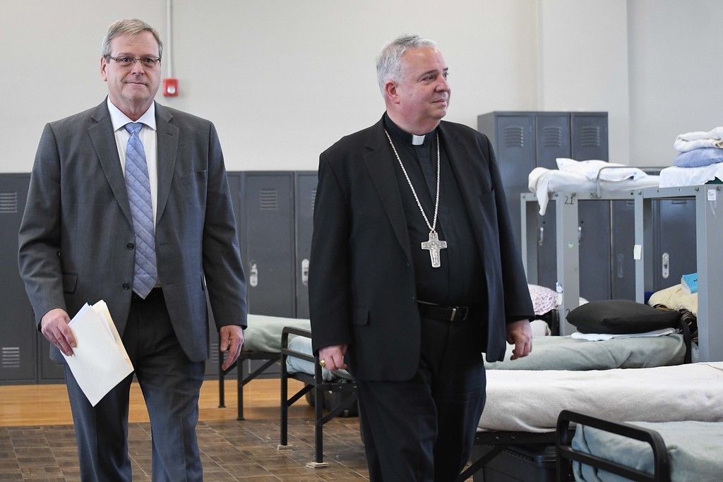 . Eric Bonzar�The Morning Journal<br> Patrick Gareau, president and CEO of Catholic Charities of the Diocese of Cleveland, left, and Bishop Nelson J. Perez tour the men\'s living quarters during the dedication ceremony of the organization\'s St. Elizabeth Center, in Lorain, Oct. 31, 2017.