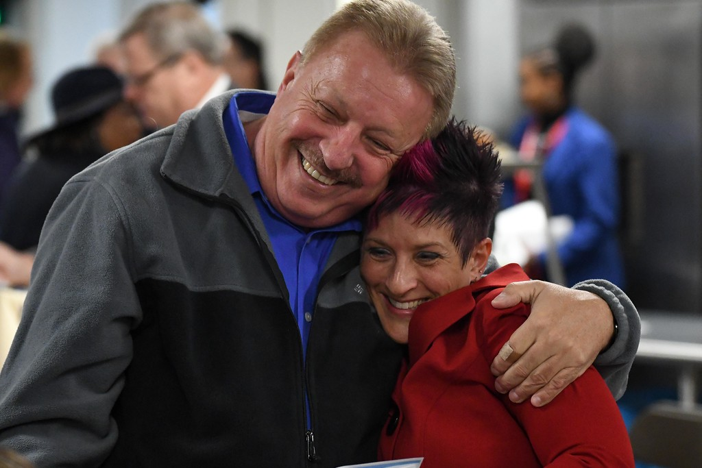 . Eric Bonzar�The Morning Journal<br> Melissa Kay Sirak, director of emergency assistance services for Catholic Charities of the Diocese of Cleveland, gets a hug from Jim Long, president of the Lorain Growth Corp., Oct. 31, 2017. The organization held a dedication of its St. Elizabeth Center, in Lorain, Tuesday afternoon.