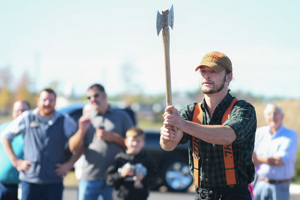 . Eric Bonzar�The Morning Journal<br> Spectators watch as Tyler Alden, of Branson, Mo., lines up his ax with a wooden target, during the Duluth Trading Co.\'s lumberjack exhibition, Oct. 5, 2017. Duluth Trading Co. opened the doors on its 35455 Chester Road location, in Avon, on Thursday.