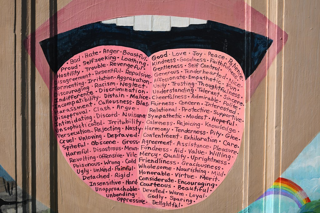 """. Eric Bonzar�The Morning Journal Artist Colleen Gimben\'s door is displayed with others\' at Vermilion\'s Friendship Park. Gimben\'s door is one of 30 painted by 33 artists for the United Church of Christ\'s \""""Unlock the Door�The Key Is Love\"""" project. The doors, placed throughout downtown Vermilion, will be auctioned off at 4 p.m., Oct. 22, at German\'s Villa."""