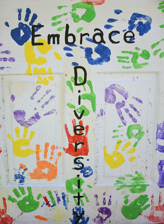 """. Eric Bonzar�The Morning Journal Vermilion United Church of Christ\'s congregational youth chose to \""""embrace diversity\"""" as its\' theme. Thirty doors painted by 33 artists for the United Church of Christ\'s \""""Unlock the Door�The Key Is Love\"""" project, placed throughout downtown Vermilion, will be auctioned off at 4 p.m., Oct. 22, at German\'s Villa."""