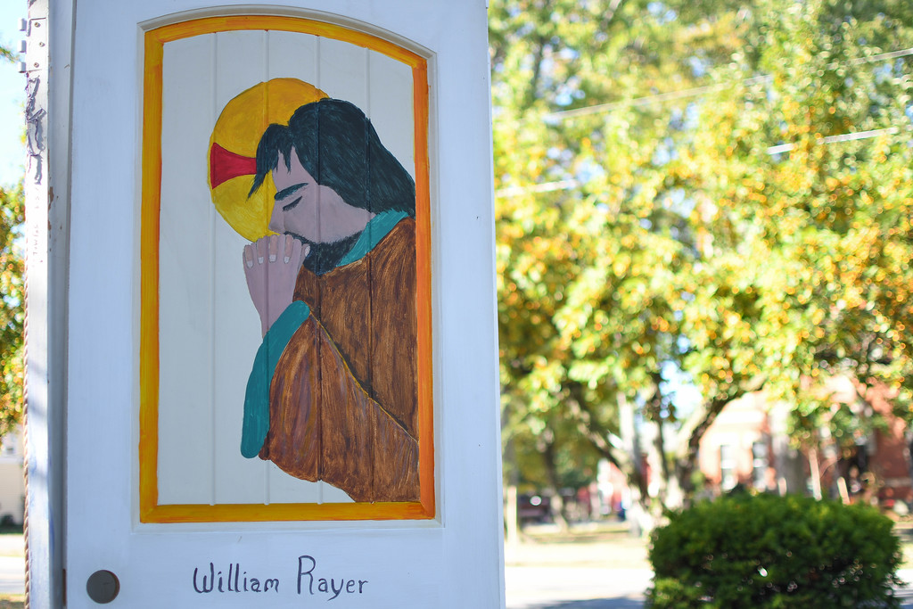 """. Eric Bonzar�The Morning Journal  Thirty doors painted by 33 artists for the United Church of Christ\'s \""""Unlock the Door�The Key Is Love\"""" project, placed throughout downtown Vermilion, will be auctioned off at 4 p.m., Oct. 22, at German\'s Villa."""
