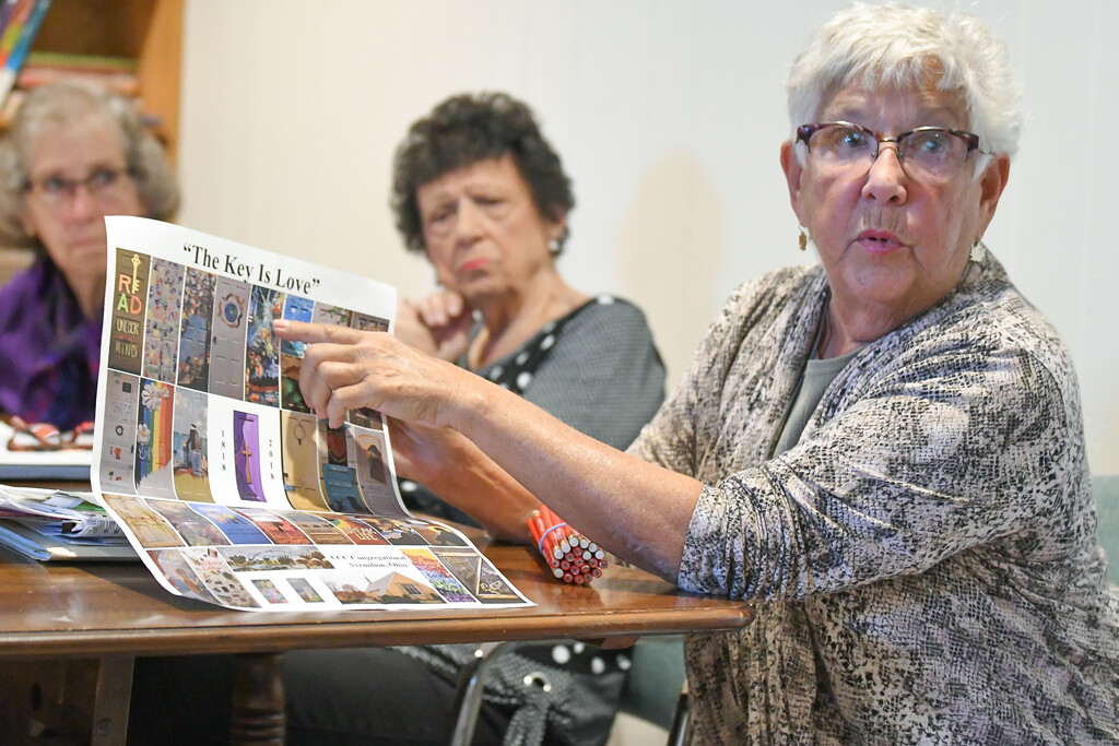 """. Eric Bonzar�The Morning Journal Judy Williams discusses the 30 doors painted by 33 artists for the United Church of Christ\'s \""""Unlock the Door�The Key Is Love\"""" project. The doors, placed throughout downtown Vermilion, will be auctioned off at 4 p.m., Oct. 22, at German\'s Villa."""