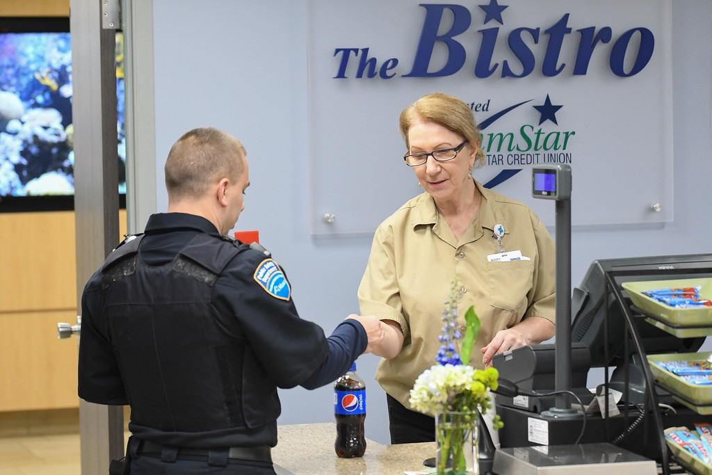 . Eric Bonzar�The Morning Journal<br> Cashier Mary Smigel checks out a customer at the newly renovated CommStar Bistro, at Mercy Health, in Lorain, Nov. 14, 2017.