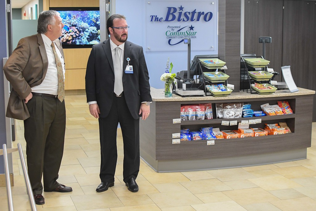 . Eric Bonzar�The Morning Journal<br> WOBL/WDLW General Manager Doug Wilber, left, and Mercy Foundation of Lorain County President Scott Pember check out the newly renovated CommStar Bistro, at Mercy Health, in Lorain, Nov. 14, 2017.