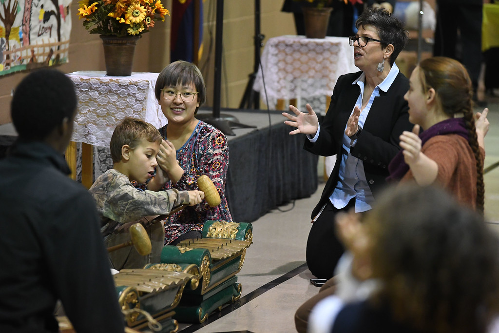 . Eric Bonzar�The Morning Journal<br> Children from the Salvation Army Learning Zone perform with Oberlin College staff during the Salvation Army of Lorain\'s Thanksgiving dinner, Nov. 21, 2017.
