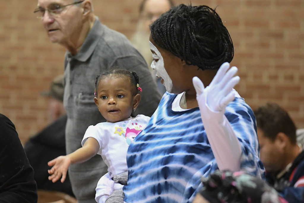 . Eric Bonzar�The Morning Journal<br> Salvation Army Learning Zone teacher Machel Donald and her 1-year-old granddaughter Audrey Jackson dance together during the Salvation Army of Lorain\'s Thanksgiving dinner, Nov. 21, 2017.