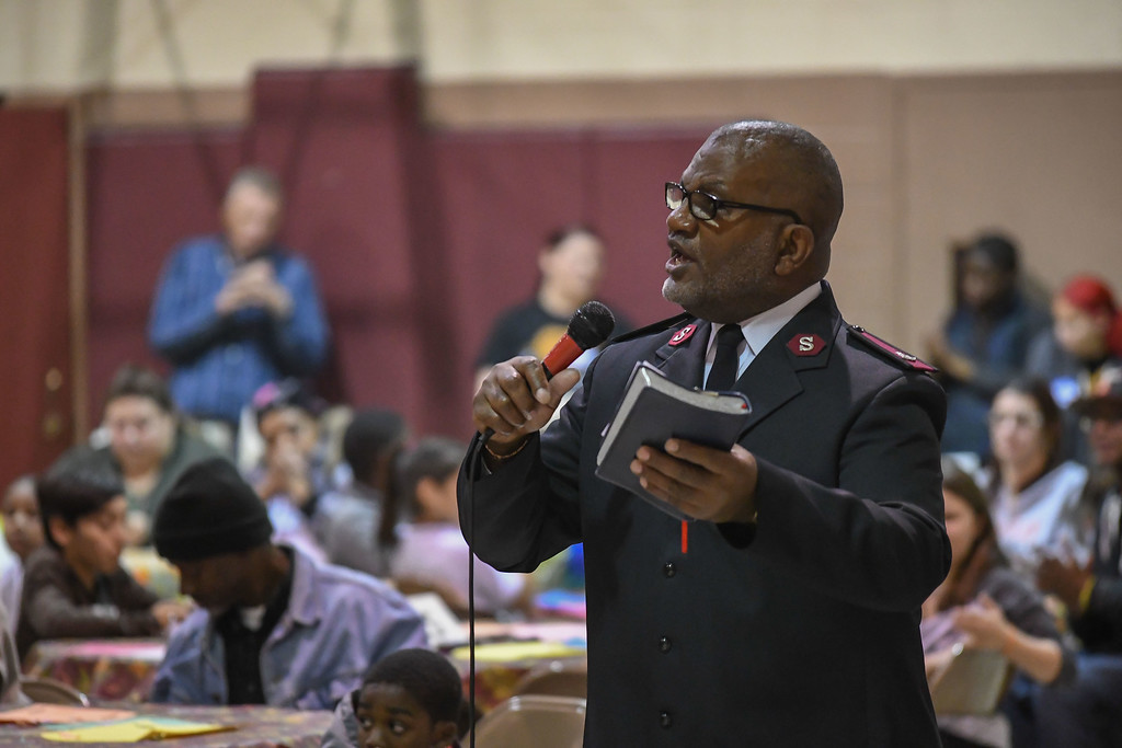 . Eric Bonzar�The Morning Journal<br> Major Robert Dixon reads from the Book of Psalms during the Salvation Army of Lorain\'s Thanksgiving dinner, Nov. 21, 2017.