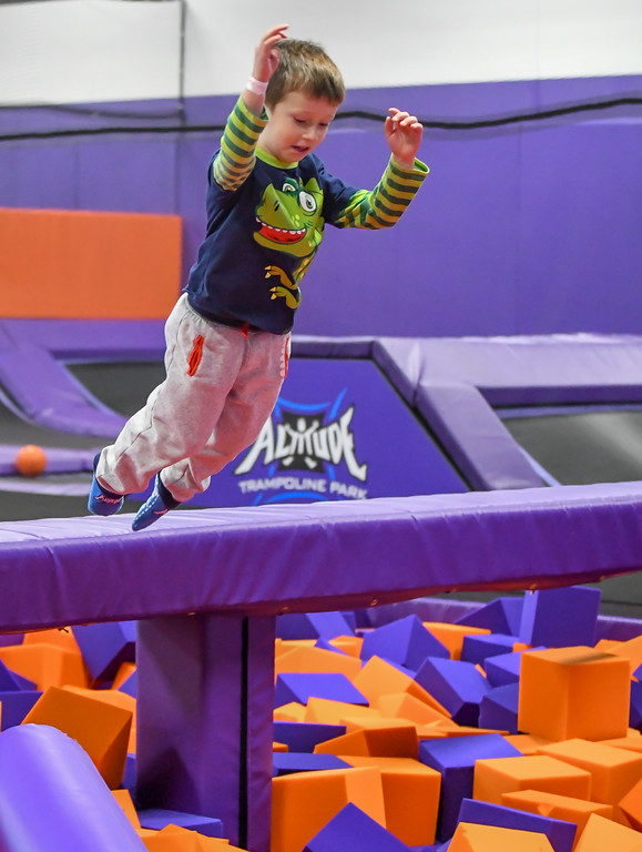 . Eric Bonzar�The Morning Journal<br> Four-year-old Jace Hune leaps into a foam block pit at Altitude Trampoline Park, Nov. 29, 2017.