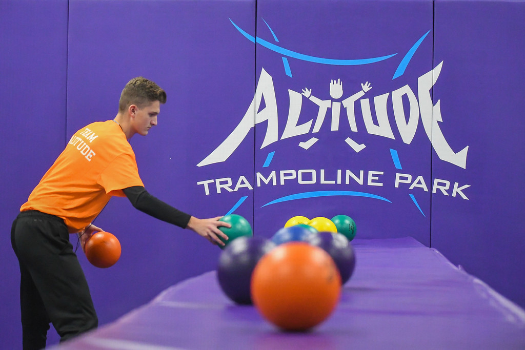 . Eric Bonzar�The Morning Journal<br> Court monitor Ben Biedenbach resets the dodgeball pit at Altitude Trampoline Park, Nov. 29, 2017.