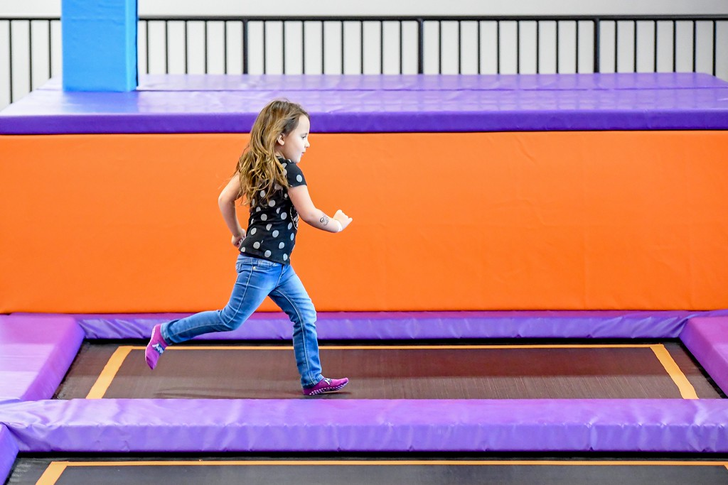 . Eric Bonzar�The Morning Journal<br> Three-year-old Bella Harshberger sprints across a trampoline pad at Altitude Trampoline Park, Nov. 29, 2017.