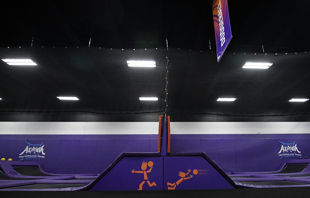 . Eric Bonzar�The Morning Journal<br> Two dodgeball pits provide a competitive experience for customers of Altitude Trampoline Park.
