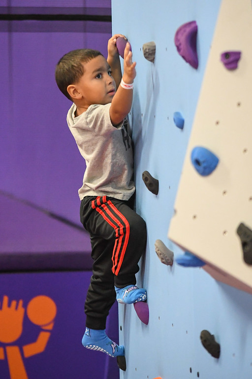 . Eric Bonzar�The Morning Journal<br> Four-year-old Brayden Small climbs the Rock Werx rock climbing wall at Altitude Trampoline Park, Nov. 29, 2017.