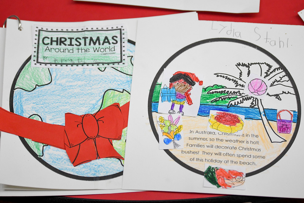 . Eric Bonzar�The Morning Journal<br> Wellington kindergartners at Westwood Elementary School are traveling the world for the holidays, as they spend the month of December learning about holiday traditions in countries across the globe.