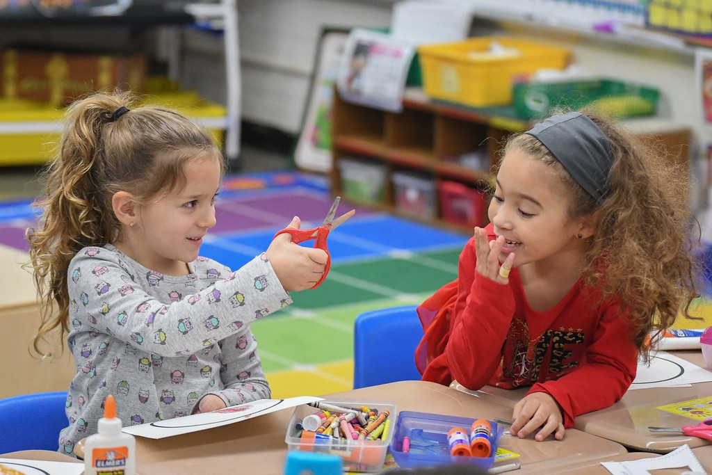 . Eric Bonzar�The Morning Journal<br> Five-year-old kindergartner Ava Ledesma, left, and  6-year-old classmate Amora Wilson decorate their Brazilian Christmas trees, during class, at Wellington\'s Westwood Elementary School, Dec. 4, 2017.