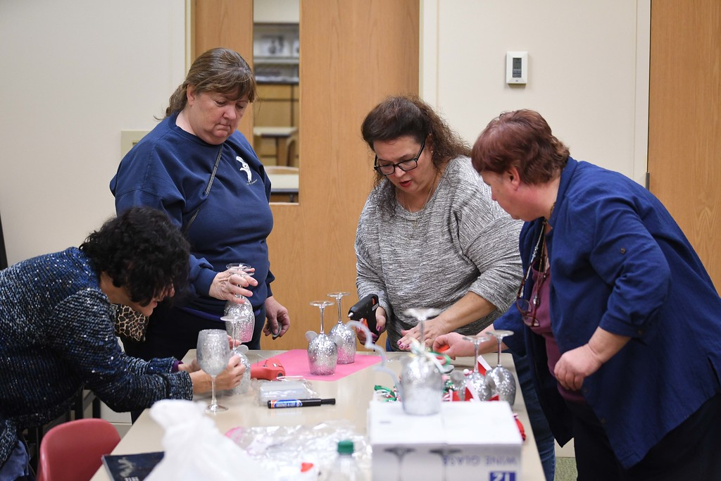 . Eric Bonzar�The Morning Journal<br> Participants create Mr. and Mrs. Mouse Claus decorations from wine glasses during an adult holiday crafting session, taught by Liz Guilkey, of Lorain, at the Lorain Public Library System\'s South Branch, Dec. 5, 2017.