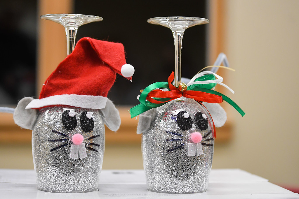. Eric Bonzar�The Morning Journal<br> Participants created Mr. and Mrs. Mouse Claus decorations from wine glasses during an adult holiday crafting session, taught by Liz Guilkey, of Lorain, at the Lorain Public Library System\'s South Branch, Dec. 5, 2017.