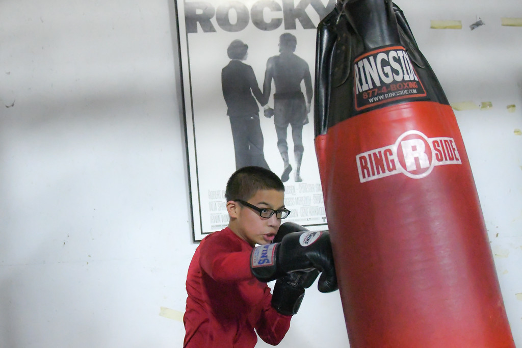 . Eric Bonzar�The Morning Journal<br> A young boxer hits the heavy bag during a workout at United Boxing Club, Dec. 6, 2017.
