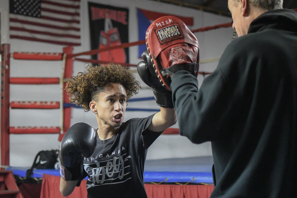 . Eric Bonzar�The Morning Journal<br> Sixteen-year-old Giovanni Rayes, of Lorain, works out with trainer Dan McDowell at United Boxing Club, in Lorain, Dec. 6, 2017.