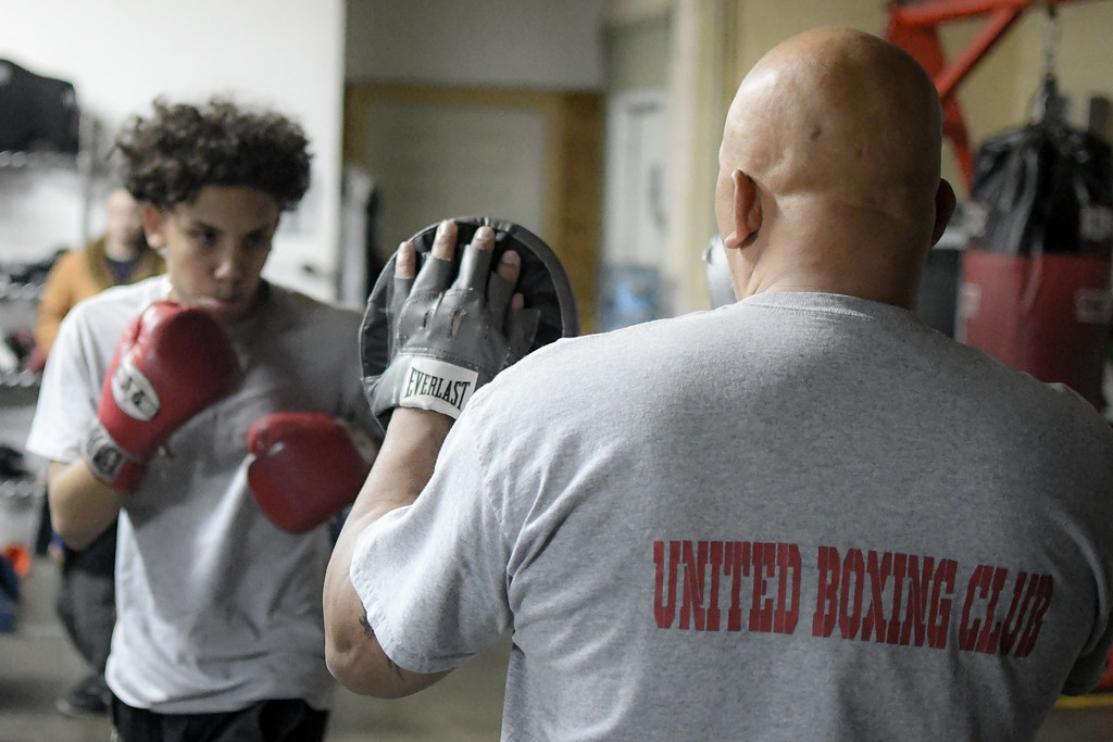 . Eric Bonzar�The Morning Journal<br> Seventeen-year-old Bryan Torres, of Lorain, works out with United Boxing Club Owner George Mills, Dec. 6, 2017.