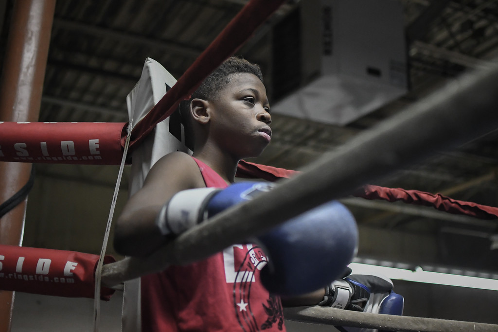 . Eric Bonzar�The Morning Journal<br> Twelve-year-old Jarel Jackson waits intently for his turn to train in the center of the ring at United Boxing Club, in Lorain, Dec. 6, 2017.