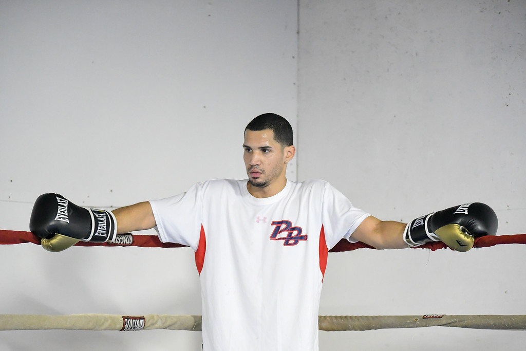 . Eric Bonzar�The Morning Journal<br> Amature pugilist Juan Rodriguez, of Lorain, takes a break in the corner of the ring during a workout at United Boxing Club, in Lorain, Dec. 6, 2017.