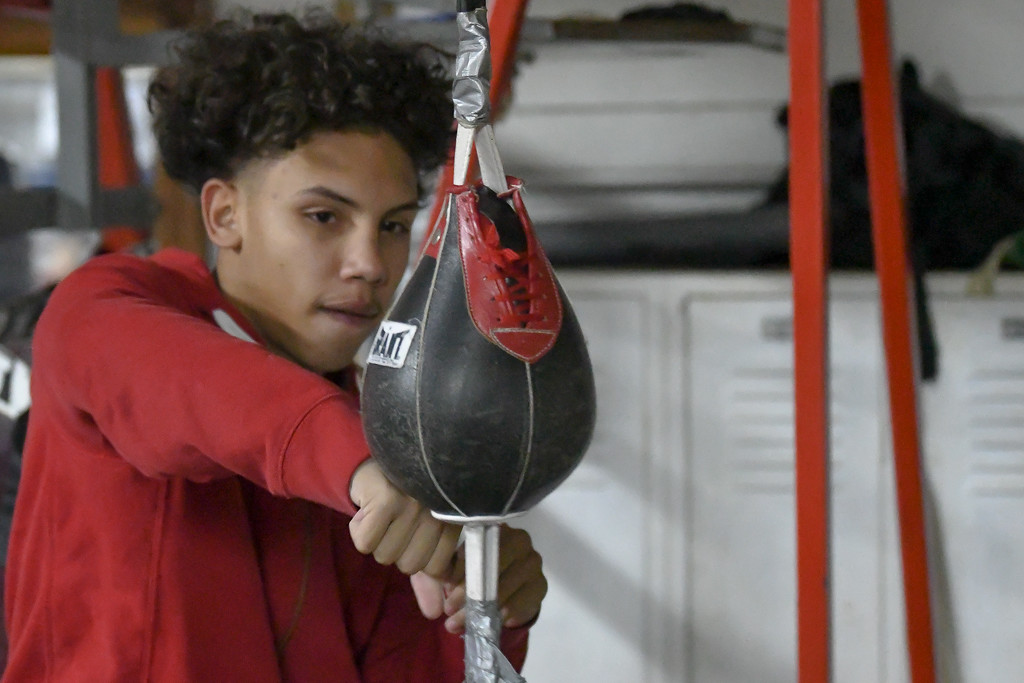. Eric Bonzar�The Morning Journal<br> Seventeen-year-old Bryan Torres, of Lorain, hits the speed bag during a workout at United Boxing Club, Dec. 6, 2017.