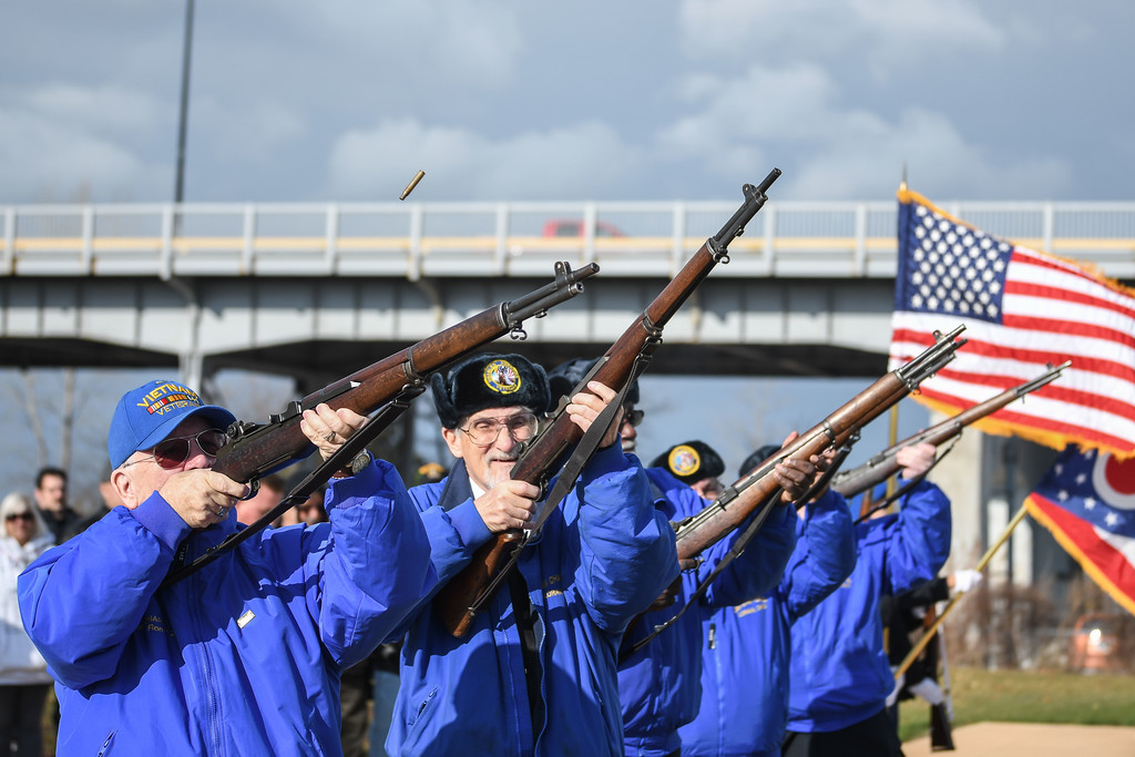 . Eric Bonzar�The Morning Journal<br> Members of Lorain AMVETS Post No. 47 give a 21-gun salute during the organization\'s Honoring Pearl Harbor Day ceremony held at Black River Landing, Dec. 7, 2017.