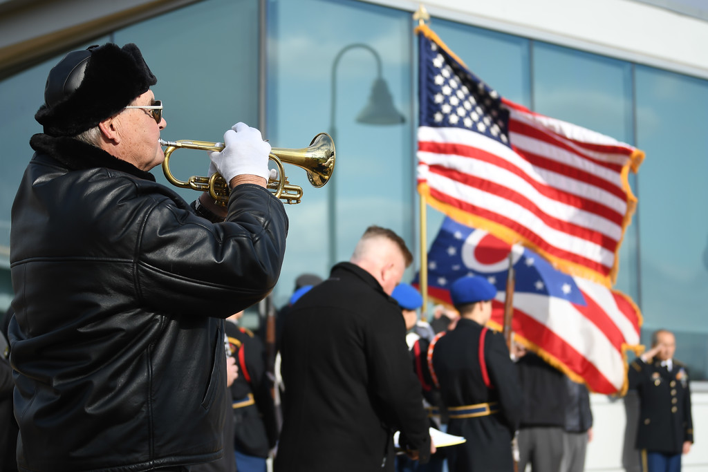 . Eric Bonzar�The Morning Journal<br> Jim Cherven, of Lorain AMVETS Post No. 47, plays taps during the organization\'s Honoring Pearl Harbor Day ceremony held at Black River Landing, Dec. 7, 2017.