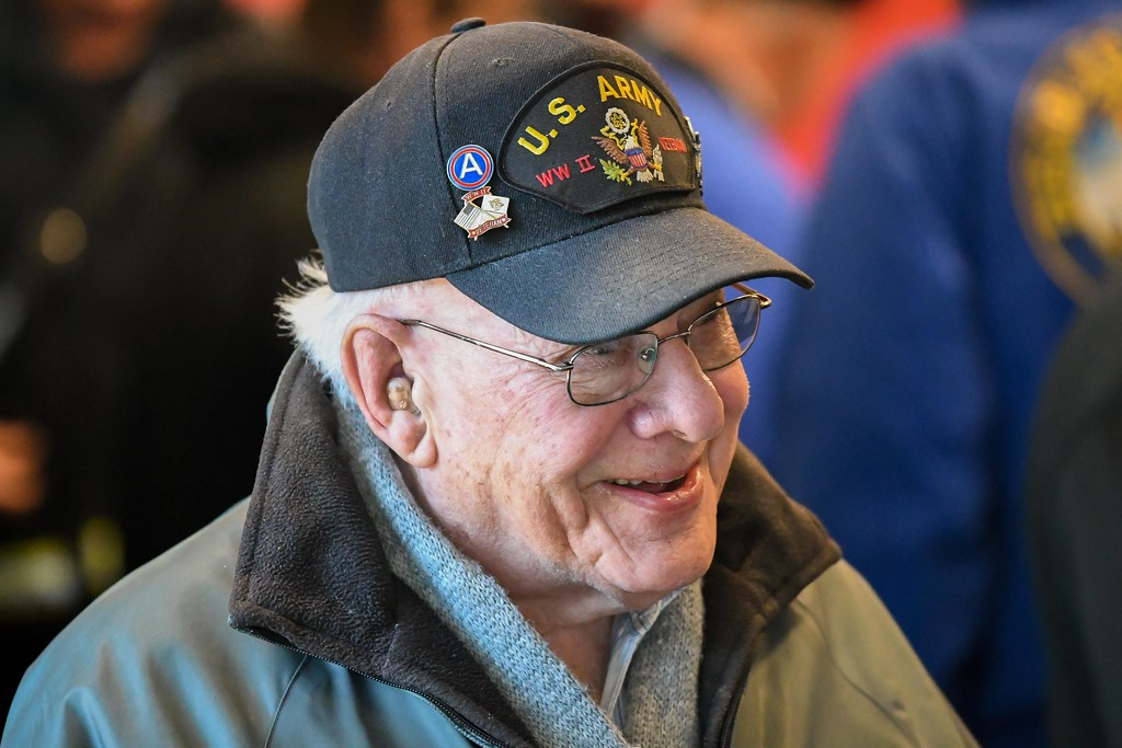 . Eric Bonzar�The Morning Journal<br> World War II Army Veteran Arthur Goodman visits with attendees of Lorain AMVETS Post No. 47\'s Honoring Pearl Harbor Day ceremony held at Black River Landing, Dec. 7, 2017.