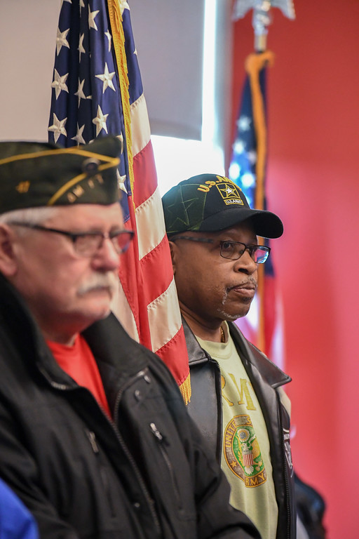 . Eric Bonzar�The Morning Journal<br> Veteran John Lacey holds on to the American flag during Lorain AMVETS Post No. 47\'s  Honoring Pearl Harbor Day ceremony held at Black River Landing, Dec. 7, 2017.