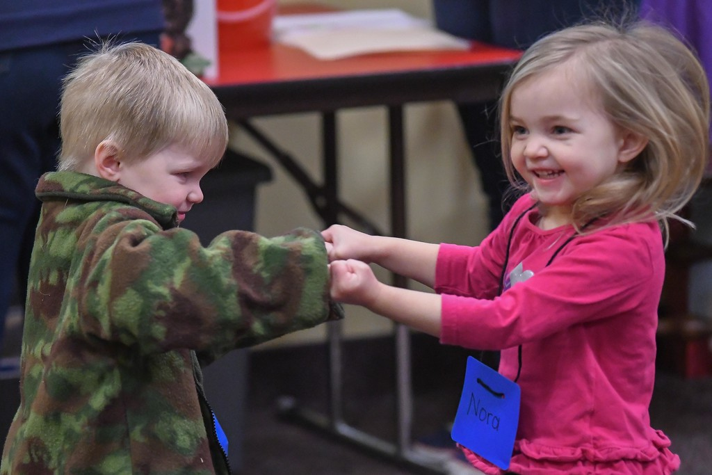 . Eric Bonzar�The Morning Journal<br> Four-year-old Nora Franz dances with her brother, 2-year-old William Franz, during Lorain Public Library System North Ridgeville Branch\'s Family Fun Story Time, Dec. 11, 2017.