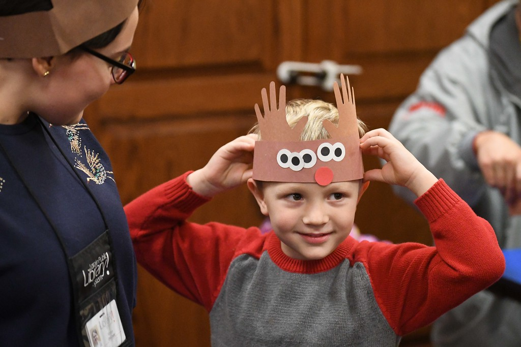 . Eric Bonzar�The Morning Journal<br> Five-year-old Bradley Wilson tries on his reindeer hat he made during Lorain Public Library System North Ridgeville Branch\'s Family Fun Story Time, Dec. 11, 2017.