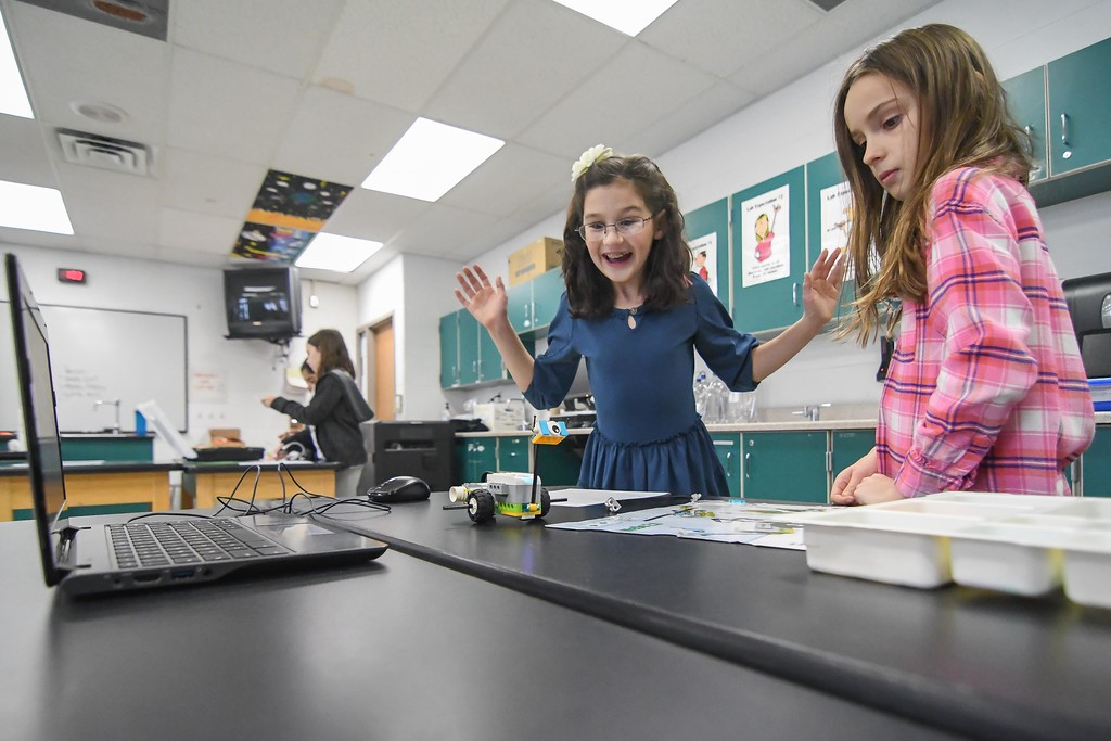 ". Eric Bonzar�The Morning Journal<br> Nine-year-old Maria Jacono reacts as she and her partner, 9-year-old Maddie Gettings program their robot ""Milo\"" to move on its own during an Hour of Code, at Avon Heritage Elementary School, Dec. 12, 2017."