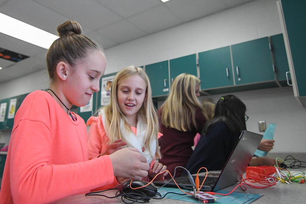 . Eric Bonzar�The Morning Journal<br> Nine-year-old Lily Crytzer, left, and 10-year-old Allie Argabright use a Makey Makey device to create music during an Hour of Code, at Avon Heritage Elementary School, Dec. 12, 2017.